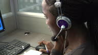 Interior shots of call centre operators wearing headsets and answering calls to 117 emergency hot line and recording information into a database at...