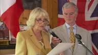 Interior shots of Camilla Duchess of Cornwall making speech in French to crowd at charity event and they give her round of applause after speech...