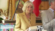 Interior shots of Camilla Duchess of Cornwall on stage after giving speech and being presented with book before speaking with people at the event...