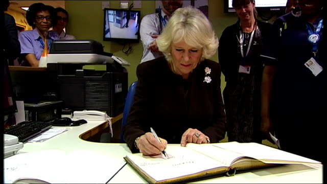 Interior shots of Camilla Duchess of Cornwall signing book at King's College Hospital during visit with Prince Charles Prince of Wales on in London...