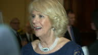 Interior shots of Camilla Duchess of Cornwall speaking to guests at a reception for Americans living and working in the UK including actress...