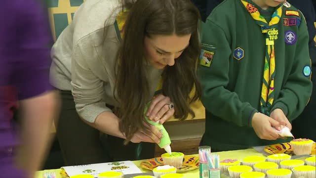 Interior shots of Catherine Duchess of Cambridge decorating cupcakes at a Cub Scout pack meeting on December 14 2016 in King's Lynn England