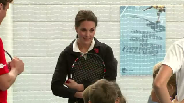 Interior shots of Catherine Duchess of Cambridge taking part in a children's coaching session and speaking to the group of children afterwards on...