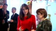 Interior shots of Catherine Duchess of Cambridge talking to a member of staff and then walk over sit down with some children on her visit to the Anna...