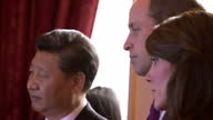 Interior shots of Chinese president Xi Jinping and wife Peng Liyuan with Prince William and Catherine Duchess of Cambridge listening to a talk by an...