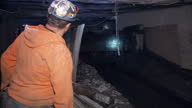 Interior shots of coal miners working in a Kentucky mine with coal moving along a conveyor belt on 20 April 2017 in Hazard Kentucky