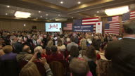 Interior shots of crowds at a Des Moines caucus rally listening and applauding as Republican presidential hopeful Jeb Bush speaks on stage on...