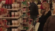 Interior shots of customers browsing goods for sale inside Harrods Department Store in London England UK on December 10th 2015 Shots Customers walk...