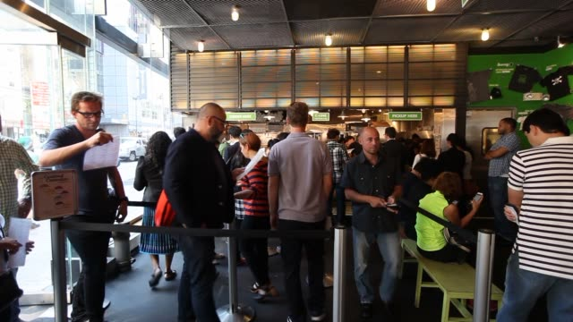 Interior shots of customers waiting on a long ordering line inside a Shake Shack in New York City Shots of customers waiting at the ordering counter...