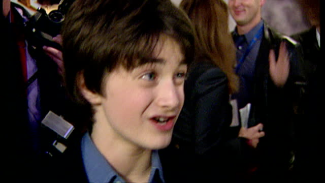 Interior shots of Daniel Radcliffe speaking to press at the premiere of Harry Potter and the Philosopher's Stone on November 4 2001 in London England