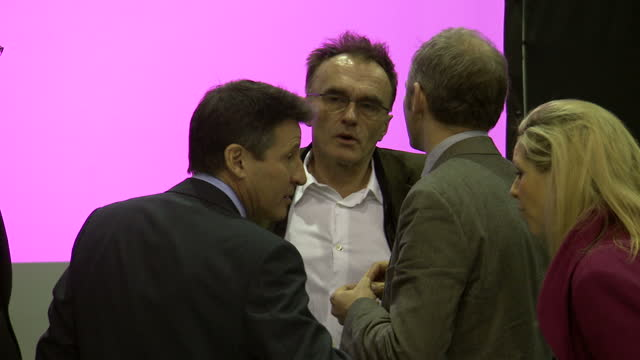 Interior shots of Danny Boyle and Seb Coe chatting with people at Olympics Opening Ceremony Theme unveiling and walking about Danny Boyle Olympics...