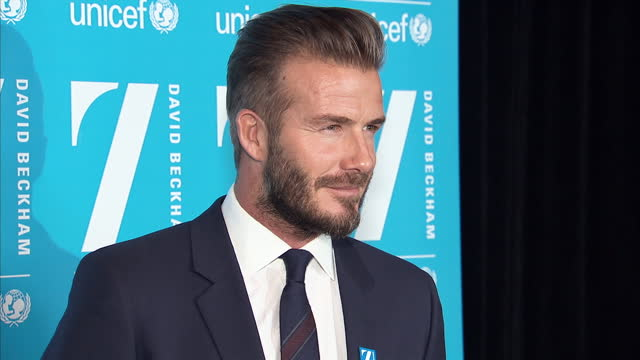 Interior shots of David Beckham posing for photo at UNICEF press conference and having photos taken by press media with flash photography on February...