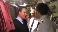 Interior shots of David Cameron on board HMS Victorious submarine meeting submariners in sleeping quarters David Cameron on board HMS Victorious on...