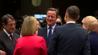 Interior shots of David Cameron walking in to a round table meeting and speaking to EU leaders including Estonian Prime Minister Taavi Roivas French...