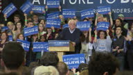 Interior shots of Democratic presidential hopeful Bernie Sanders speaking to crowds of supporters at a NH Primary rally with lots of cutaways to his...