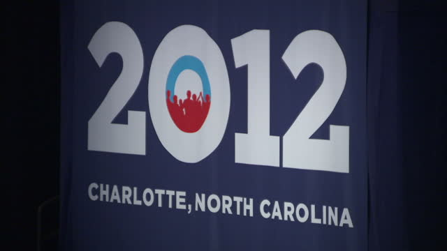 Interior shots of democrats gathered in a convention hall in North Carolina for a speech by Barack Obama in the run up to the 2012 US Presidential...