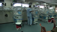 Interior shots of doctors and nurses caring for new born babies on a neonatal ward on July 23 2014 in Gaza Israel