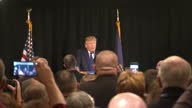 Interior shots of Donald Trump addressing supporters at rally and shots of audience clapping on December 10 2015 in Portsmouth New Hampshire