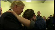 Interior shots of Donald Trump being prayed for by a churchgoer during a visit to an evangelical church in Council Bluffs Iowa on January 31 2016 in...