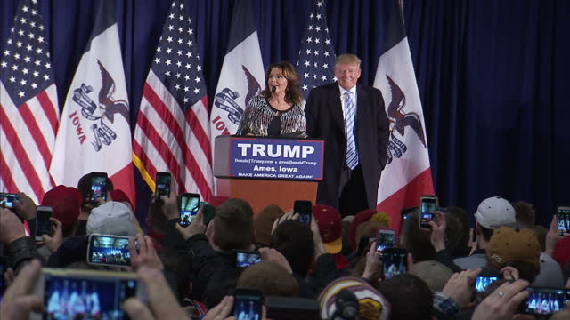 Interior shots of Donald Trump welcoming Sarah Palin onto stage during a republican rally in Iowa on January 19 2016 in Ames Iowa