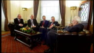 Interior shots of Dr Ian Paisley Martin McGuiness Bertie Ahern Tony Blair and Peter Hain sitting on sofa all having a laugh and joking with each...