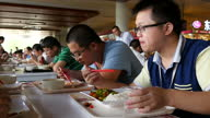 Interior shots of employees of Huawei eating lunch in the company's canteen on September 20 2015 in Shenzhen China