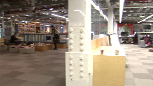 Interior shots of Facebook's London offices with open plan office areas and staff sat chatting and using laptop computers on February 02 2015 in...