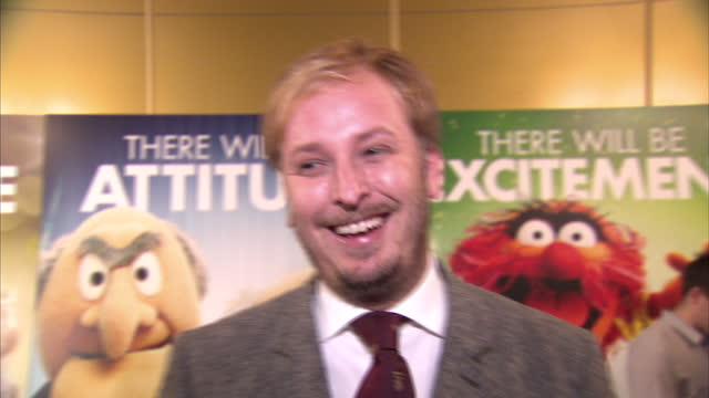 Interior shots of film director James Bobin giving an interview at The Muppets premiere at The Mayfair Hotel on January 26 2012 in London England