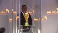 interior shots of Former Brazil captain Cafu placing FIFA World Cup trophy in display case and pose for photos with former footballer Renate Lingor...