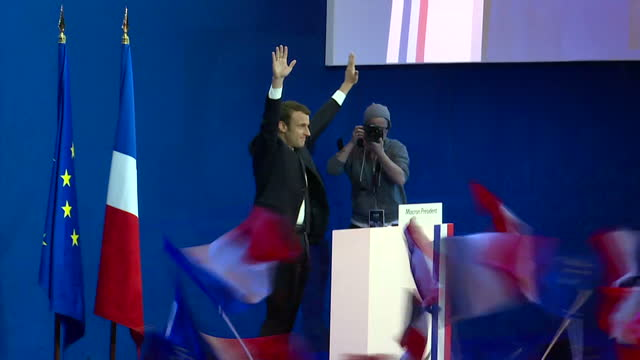 Interior shots of French presidential candidate Emmanuel Macron speaking to a crowd of cheering supporters at a rally on 23 April 2017 in Paris France