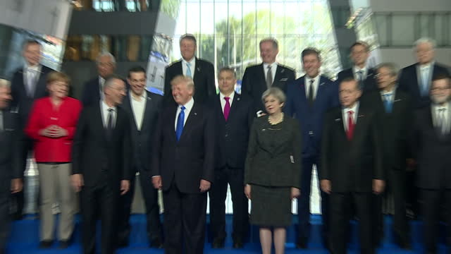 Interior shots of G8 Summit and NATO Leaders posing for family photo op including Turkish President Recep Tayyip Erdogan US President Donald Trump...