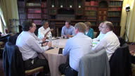 Interior shots of G8 world leaders sitting in round table meeting including Barack Obama David Cameron Angela Merkel Enda Kenny Jose Barroso Herman...