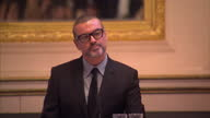 Interior shots of George Michael walk into press conference and speak about his return to live performance with a 47date tour of Europe that will see...