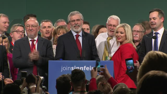 Interior shots of Gerry Adams being joined on stage by fellow Sinn Fein officials including Sinn Fein leader Michelle O'Neill receiving embraces and...