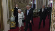 Interior shots of guests entering the Ballroom of Buckingham Palace for a ceremony to present the 2017 Queen's Young Leaders Award followed by the...
