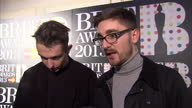 Interior shots of Gus UngerHamilton and Thom Green of AltJ band giving an interview at the Brit Awards nominations party at The Savoy Hotel on...