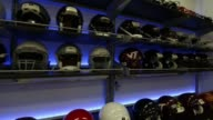 Interior shots of helmets stacked on racks against a wall at Virginia Tech University in Blacksburg Virginia on 010715 Wide shots of helmets stacked...