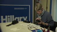 Interior shots of Hillary Clinton's campaign team on phones to potential supporters canvassing on February 7 2016 in Hooksett New Hampshire