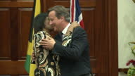 Interior shots of Jamaican Prime Minister Portia Simpson Miller embracing British Prime Minister David Cameron>> on September 30 2015 in Kingston...