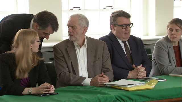 Interior shots of Labour leader Jeremy Corbyn looking uncomfortable as cameras film a meeting of the Shadow Cabinet whispering to press secretary...