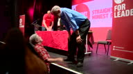 Interior shots of Labour leadership hopeful Jeremy Corbyn climbing down from the stage during a campaign rally in Aberdeen and speaking to party...