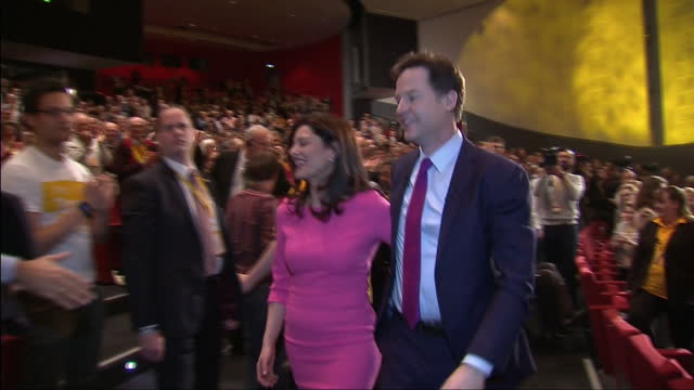 Interior shots of Liberal Democrat leader Nick Clegg waving and walking off stage after making his speech at the Liberal Demcrat Spring Conference...