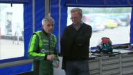 Interior shots of Lord Drayson Chief executive of Drayson Racing getting into the B12 69/EV electric car wearing full racing gear Interior shots of...
