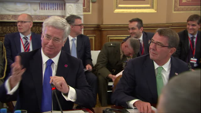 Interior shots of Michael Fallon sitting in a meeting with other defense secretaries including Ash Carter United States Secretary of Defense and...