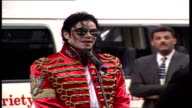 Interior shots of Michael Jackson speaking about how important children are before presenting a set of keys John Webber