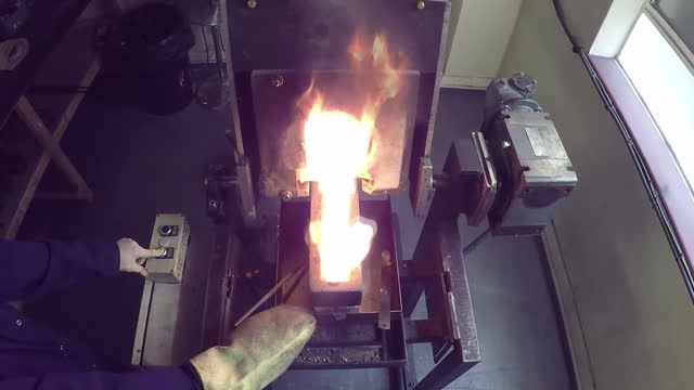 Interior shots of molten gold being poured from a smelting pot into a mold to form ingots on August 24 2015 in London England