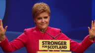 Interior shots of Nicola Sturgeon First Minister for Scotland SNP leader receiving a standing ovation as she walks on stage to give her keynote...