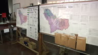 Interior shots of office staff monitoring cases of Ebola and updating area charts and maps with new data departments include 'surveillance alerts'...
