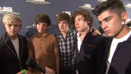 Interior shots of One Direction band members Niall Horan Liam Payne Zayn Malik Louis Tomlinson and Harry Styles giving an interview at 'Eyes Wide...