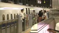 Interior shots of passengers inside The Tokaido Shinkansen Kyoto Station boarding a bullet train on 30th August 2017